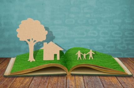 Paper cut of family symbol on old grass book photo via Shutterstock (http://shutr.bz/17SQBy7)