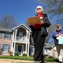 Marty Scrima, (left) and Jim Wedick, members of the Holy Infant Catholic Church evangelization team, work the New Ballwin Estates subdivision in Ellisville on Saturday, April 20, 2013, going door to door, re-welcoming registered members to restart an active membership at the church and taking suggestions on how to make worship better. Photo by Christian Gooden / St. Louis Post-Dispatch