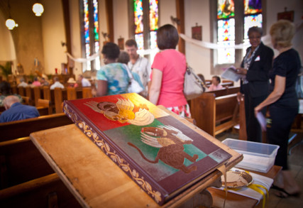 The Bible rests on a stand at the back of St. Therese Little Flower parish in Kansas City, Mo. on Sunday, May 20, 2012. RNS photo by Sally Morrow