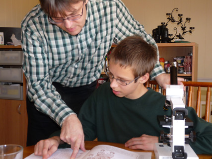 """""""In Germany there is basically religious freedom, but it ends at least with teaching the children,"""" Uwe Romeike (pictured here teaching his son) says in a video produced by the Home School Legal Defense Association, the Christian organization providing the family's legal support. Photo courtesy Home School Legal Defense Association"""