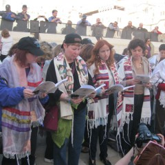 Despite a court decision stating women cannot don prayer shawls at the Western Wall, many members and supporters of Women of the Wall pray with prayer shawls. They want the Israeli government to accommodate the needs of all Jews at the Wall, not just those of the ultra-Orthodox. RNS photo by Michele Chabin