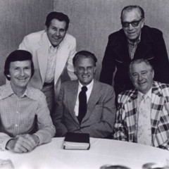 Veteran members of the Billy Graham team who were with the evangelist during his 1952 campaign in Jackson, Miss., pause for a visit before beginning their 1975 Mississippi Crusade. (From left to right) Tedd Smith, pianist; Cliff Barrows, song leader and program director; Graham; George Beverly Shea, soloist; and Grady Wilson, associate evangelist. Religion News Service file photo. 1975