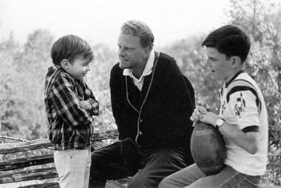 Billy Graham tried to save the world, traveling for months at a time to more than 170 countries to preach the Gospel to tens of millions. In a rare moment at home in 1965, he spends time with sons Ned (left) and Franklin. Photo from Graham collection published in his book, ``Just As I Am'' by Harper San Francisco