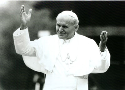 "Pope John Paul II gestures in a still from the PBS frontline show, ""John Paul II: The Millennial Pope."" The pontiff, who has always attracted media attention is the subject a new book as well the PBS television show airing Sept. 28. Religion News Service file photo"