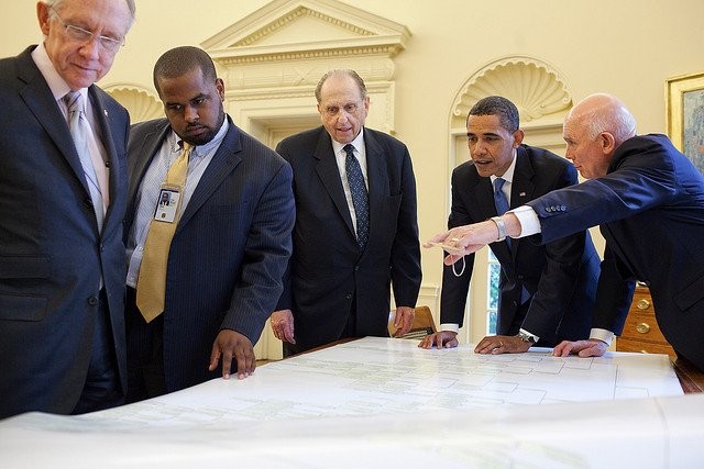 President Barack Obama meets with (from left) Senator Harry Reid, Joshua DuBois, Director of the White House Office for Faith-Based and Neighborhood Partnerships, LDS Church President Thomas Monson and Elder Dallin Oaks in the Oval Office on July 20, 2009. During the meeting they looked at a five volume geneology prepared by the Church's Family History Committee. Photo courtesy The White House/Pete Souza