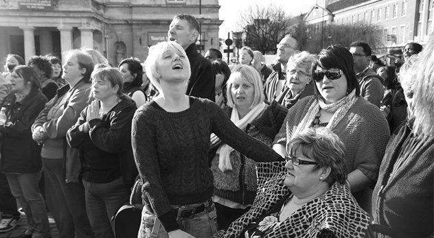 Faith healer prays over woman in wheelchair in Victoria Square - image courtesy of Martin Upfold, Flickr Creative Commons (http://bit.ly/11fyJXh)