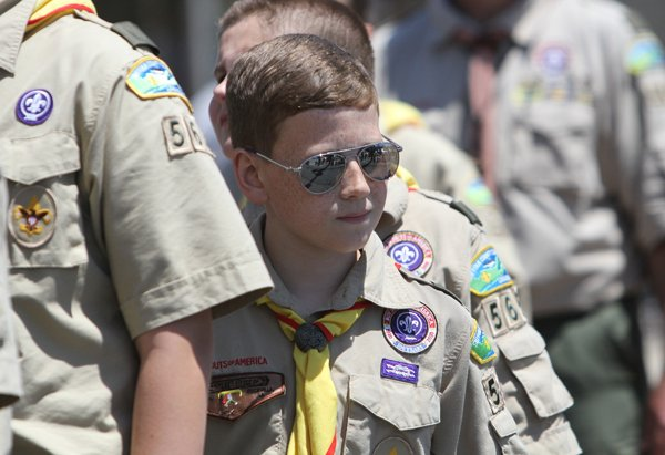 A Boy Scout marches with his troop during the Memorial Day parade in Smithtown, N.Y., May 27. RNS photo by Gregory A. Shemitz
