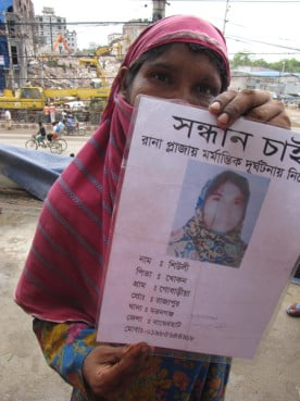 Ranjana Akhter, 35, holds a picture Wednesday of her missing daughter Sheuli Akhter, 20, while standing opposite the ruins of Rana Plaza where Sheuli worked. The building, packed with garment factories on illegally built additional stories, collapsed April 24 in a suburb of the Bangladesh capital Dhaka. Photo by Calum MacLeod/USA Today