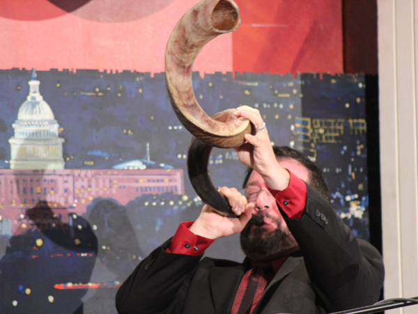 Rabbi Neal Surasky of Chosen People Ministries in New York blows the shofar at the National Day of Prayer observance in the Cannon House Office Building in Washington on Thursday (May 2). RNS photo by Adelle M. Banks
