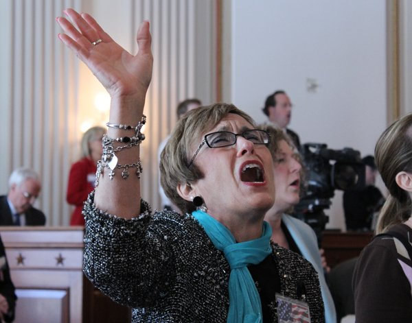 Anita Hensley of Kansas City, Mo., joins in worship at the National Day of Prayer observance on Capitol Hill on Thursday (May 2). RNS photo by Adelle M. Banks