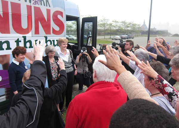 "Supporters pray during the ""Nuns on the Bus"" kick-off rally on May 29, 2013 at Liberty State Park in Jersey City, N.J. RNS photo by David Gibson"