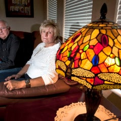 Ken and Lyn McGuire with a dragonfly lamp in their Draper, Utah home Thursday May 2, 2013. The couple is associated with an LDS Church affiliated support group, for people who've lost family members to suicide. They lost  their own son to suicide. Photo by Steve Griffin | The Salt Lake Tribune