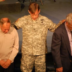 Scott McChrystal, a retired Army chaplain and the military/VA representative for the Assemblies of God, prays during a church service with other veterans. RNS photo courtesy Scott McChrystal