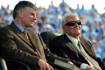Evangelist Billy Graham (r), with son Franklin Graham, at a crusade in New York on Sunday (June 26). Photo by Michael Falco