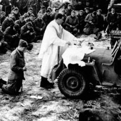 Using the front of a jeep for an altar, Roman Catholic chaplain Joseph Kenny celebrates Mass for men of the 3rd Battalion, 82nd Airborne Division, before they depart France for the field in Belgium, January 6, 1945. Photo courtesy U.S. Arm Chaplain Museum, Fort Jackson, South Carolina
