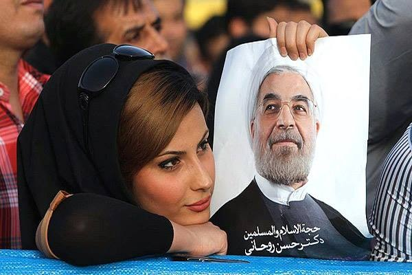 Iranian woman holding up Rouhani sign