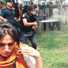 lady in red tear gas in Taksim