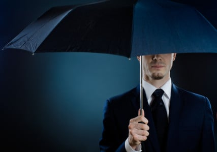 Portrait of a man in a suit with an umbrella courtesy Shutterstock