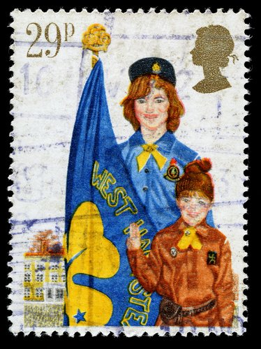 A used postage stamp printed in Britain celebrating Youth Organisations showing the Girl Guide Movement, circa 1982.  <a href=