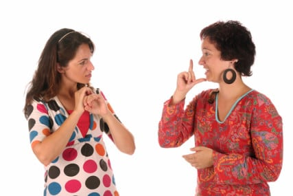 Deaf people have no sign language Bible, but a group in Japan wants to change that. Image of deaf people conversing courtesy of Vladimir Mucibabic via Shutterstock http://shutr.bz/16fjen9