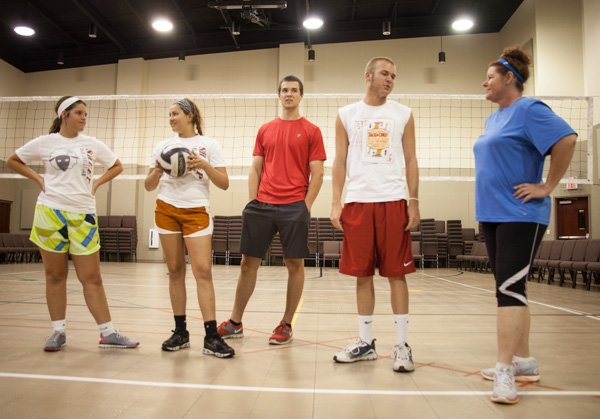 Team Royal gathers before the Christian vs. atheist volleyball tournament. Members of Abundant Life Baptist Church and Kansas City Atheist Coalition came together to face off at the net during a charity volleyball tournament on Saturday, June 22 in Lee's Summit, Mo. The group started with a discussion between believers and non-believers on a Facebook page that now has almost 300 members.  The event raised money for Drumm Farm Center for Children, an organization that aims to help children in foster care. Religion News Service photo by Sally Morrow