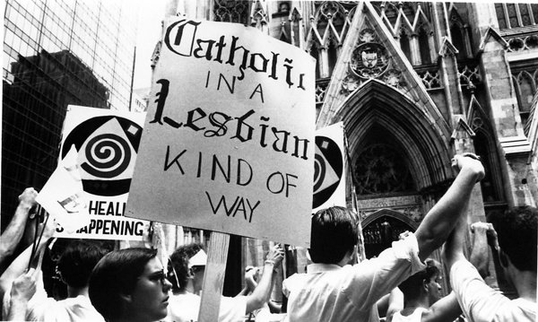"(New York) Hundreds of thousands of gay and lesbian people, accompanied by friends and families, took to the streets June 25, 1989, for the annual Gay Pride Parade. Similar parades, as well as rallies, street fairs and religious services, were celebrated in more than 80 cities across the country.  This year's parade also marked the 20th anniversary of the Stonewall Riots in New York when, for the first time in history, gay and lesbian people banded together in spontaneous demonstrations to oppose violence and discrimination.  Large groups of Jewish, Catholic and Protestant people marched behind banners bearing the names of their synagogues and churches to voice their support of the gay liberation movement.  Many of the groups, including this one called ""HEAL"", paused in front of St. Patrick's Cathedral to pray for or shout ""shame"" at the two-dozen counter-demonstrators, many bearing rosary beads, Bibles and signs quoting scripture, who had gathered there to protest the marchers.  Religion News Service file photo by Odette Lupis."
