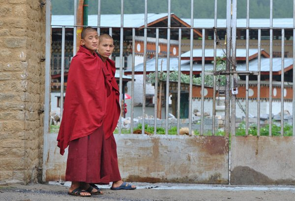 Two young monks at the gate of a monastery in Thimphu. Photo by Vishal Arora