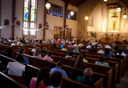 Parishioners listen to the homily during Catholic mass at St. Therese Little Flower parish in Kansas City, Mo. on Sunday, May 20, 2012. RNS photo by Sally Morrow