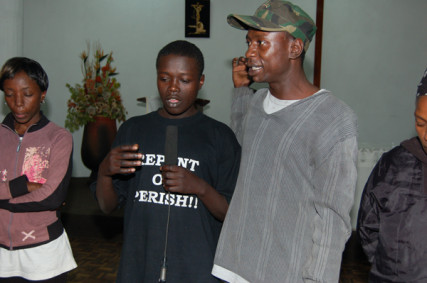 Juma Kariuki (right), a former street boy in Nairobi helps another boy (left) tell his story. Kariuki abused drugs while on the streets before he was rescued and rehabilitated by a church group. Photo by Fredrick Nzwili