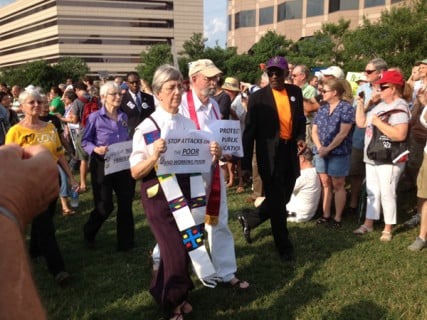 Two clergy members march against cuts to education during the seventh Moral Monday protest on June 17 in Raleigh, N.C. Photo by Anna Scott/WilmingtonFAVS.com