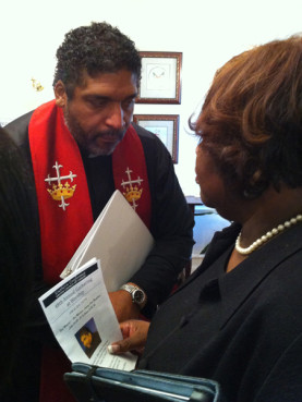 The Rev. William J. Barber II consulting with church member Shyrl Hinnant Uzzell. RNS photo by Yonat Shimron