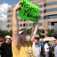 """A man holds a """"Respect Teachers"""" sign at the June 17 Moral Monday protest in Raleigh, NC. The NAACP-led protests have recently become more organized around specific issues like education, environment, Photo by Anna Scott/WilmingtonFAVS.com"""