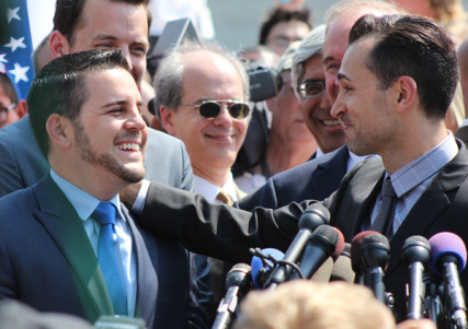 Plaintiffs Paul Katami, left, and Jeff Zarillo, who argued against California's Proposition 8, speak to the media Wednesday (June 26) after the Supreme Court rejected Prop 8 on legal grounds. RNS photo by Adelle M. Banks