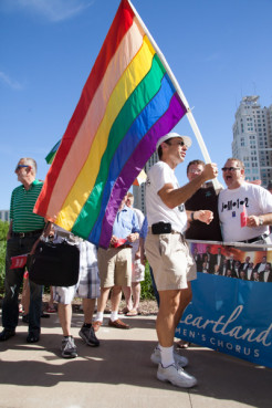 Randy Hite holds a gay pride flag during a rally celebrating the Supreme Court's gay marriage ruling at Ilus W. Davis Park in Kansas City, Mo. on Wednesday (June 26).  RNS photo by Sally Morrow