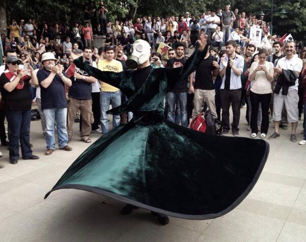 whirling dervish with tear gas mask