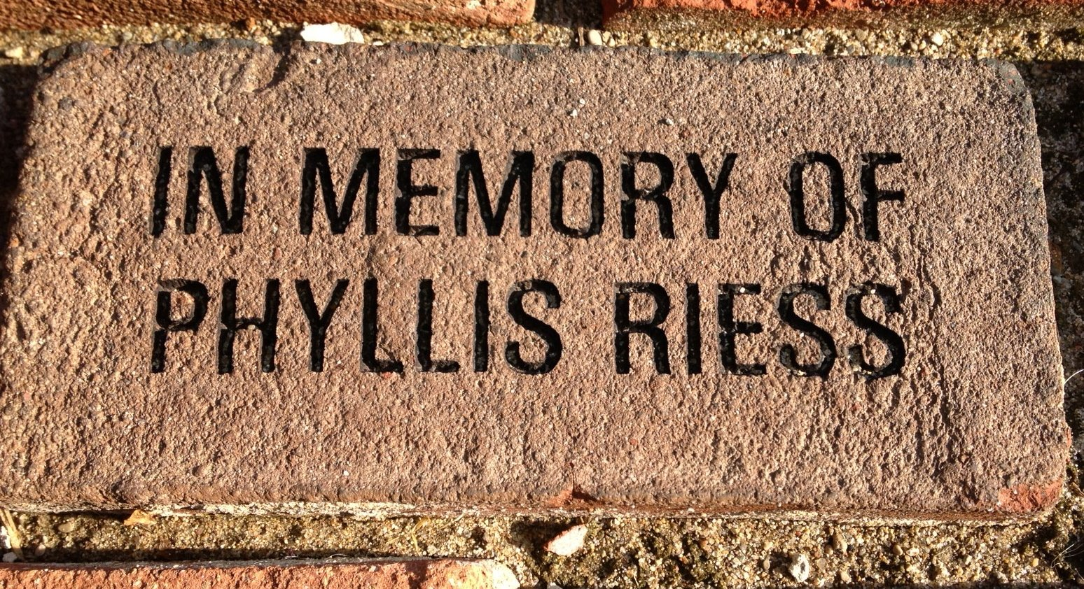 This brick is now in the walkway leading up to our neighborhood library. I think my mom, who loved to read, would be pleased. Today is the six-month anniversary of her death. (Author photo)