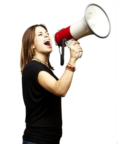 Young woman shouting into megaphone. Photo courtesy Shutterstock
