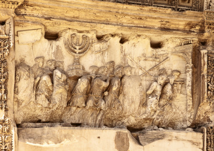 This wall relief on the Arch of Titus reveals Roman soldiers after the destruction of the Temple of Jerusalem in 70 A.D including the Temple Menorah, the Table of the Shewbread and silver trumpet. Photo courtesy Shutterstock