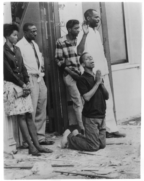 (1963) A man falls to his knees in prayer amid shattered glass from windows of the 16th Street Baptist church and surrounding buildings in Birmingham, Ala. Four young girls dies as a racist's bomb exploded at 10:22 a.m. on Sept. 15 during worship services and Sunday school sessions. In the following outbreak of violence throughout the area, two young black men were shot to death. Pleas for effort to stop further bloodshed were issued from government, civil rights and religious leaders across the nation. Religion News Service file photo *This day in history: On July 24, 1919 a race riot in Washington, D.C. left 6 dead and 100 wounded.