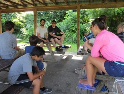 Counselor Paul Chiariello (left) and counselor-in-training Marshall Lynn lead campers in a Socrates Café-style discussion about the difference between atheism and agnosticism at Camp Quest Chesapeake. RNS photo by Corrie Mitchell