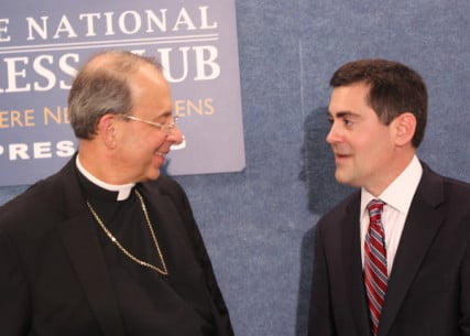 Archbishop William Lori of Baltimore, left, and Russell Moore, president of the Southern Baptist Convention's Ethics & Religious Liberty Commission, talk after news conference Tuesday (July 2) at the National Press Club in Washington. They spearheaded an open letter by faith leaders who consider the Obama administration's contraception mandate a threat to religious freedom. RNS photo by Adelle M. Banks