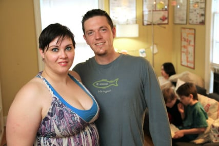 KellyAnne Kitchin with her husband Daniel Kitchin III in their home. RNS photo by Rick Foster