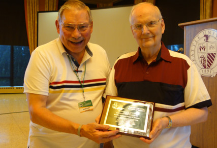 (Left) Fr. Dave Cooper, Milwaukee  - AUSCP, Board Chair presents the Blessed John XXIII Award to Bishop Donald W. Trautman (right), Diocese of Erie, PA., for his dedication to the love of the liturgy and for his devotion to priestly and episcopal ministry in the liturgical renewal envisioned by the Second Vatican Council. Photo courtesy Association of US Catholic Priests (AUSCP)