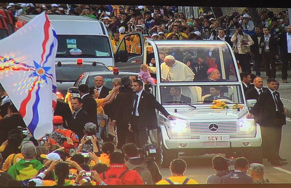 Pope Francis in his popemobile on the way to Copacabana Beach in Brazil for the re-enactment of the Way of the Cross. RNS photo by Robson Coehlo