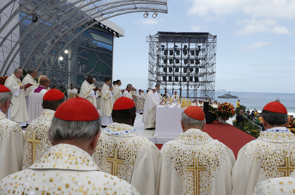 Cardinals stand beside the altar as Pope Francis celebrates the closing Mass of World Youth Day on Copacabana beach in Rio de Janeiro July 28. Photo by Paul Haring/Catholic News Service