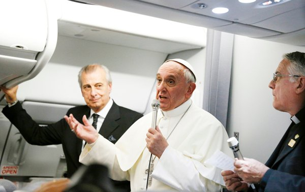 Pope Francis addresses journalists on his flight from Rio de Janeiro to Rome July 29. The pope spent 80 minutes answering questions from 21 journalists on the plane. Photo by Paul Haring/Catholic News Service