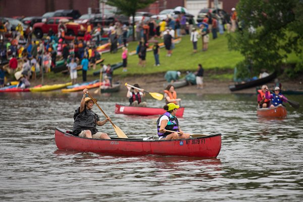 Participants enter the water and take their place in one of the two rows of paddlers in Albany, NY on Sunday (July 28).  Over 200 Native and non-Native paddlers launch onto the Hudson River to travel from Albany, NY to the United Nations in New York City to honor and renew the Two Row Wampum treaty agreed upon in 1613. RNS photo by Brett Carlsen