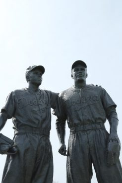 Statue of Pee Wee Reese putting his arm around Jackie Robinson, depicting the moment in 1947 when Reese signaled to a hostile crowd that Robinson, the first black player in major league baseball, was one of the team. The statue, outside a Coney Island minor league field, was defaced this week with a swastika and racial and anti-Semitic slurs.