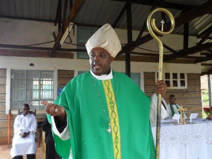 Rev. Peter Njogu, a former Roman Catholic priest who is now  the bishop of Restored Universal Apostolic Church (RUAC) contacts a mass in the Church. RNS photo by Fredrick Nzwili