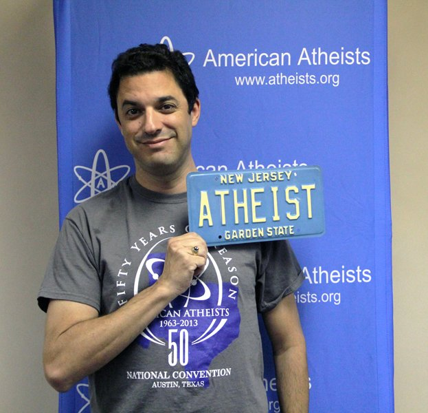 "David Silverman with retired ""ATHEIST"" New Jersey plate. Photo courtesy Dave Muscato/American Atheists"